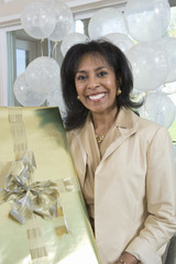 Portrait of an African American woman holding gift