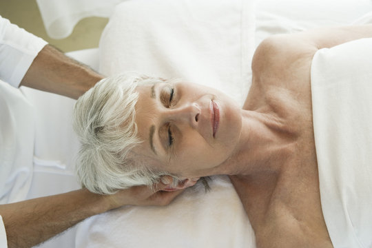 Senior woman having head massage