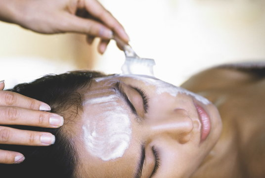 Woman having a facial, Kirana Spa, Indonesia