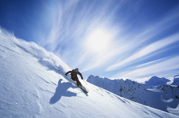 Full length of skier skiing on fresh powder snow Wall mural