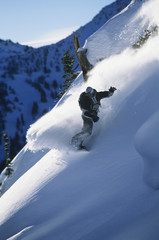 Full length of snowboarder in motion on mountain slope