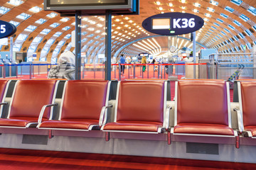 Fotobehang Luchthaven red seat in departure lounge of airport