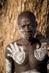 Mursi tribesman, Mursi Hills, Mago National Park, Lower Omo Valley, Ethiopia, Africa