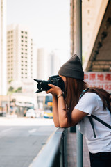 Woman photographer take a image Cityscape at Hong kong city.,vintage tone