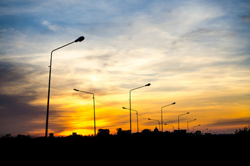 Siluate street light against twilight background Fotomurales