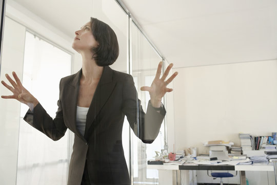Middle aged businesswoman trapped in office
