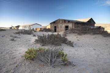 Buildings in the abandoned former German diamond mining town of Kolmanskop on the edge of the Namib Desert, Forbidden Diamond Area near Luderitz, Namibia