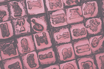 Close up of type set rubber stamps Vintage Retro Filter.