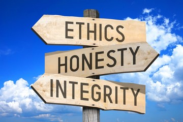 Ethics, honesty, integrity - business concept - wooden signpost