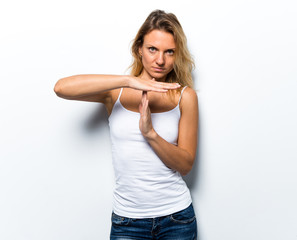Pretty young woman making time out gesture