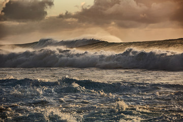 Sunset stormy ocean waves
