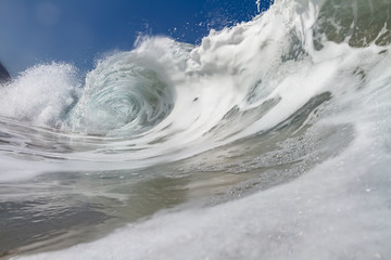 White foamy ocean shorebreak wave