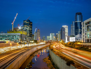 Night view of Ayalon highway over skyscrapers of Tel Aviv.
