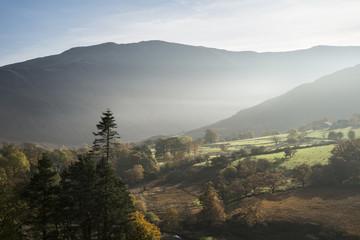 Beautiful Autumn Fall sunrise foggy landscape image over country