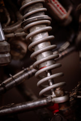 Color shot of a dirty car shock absorber.