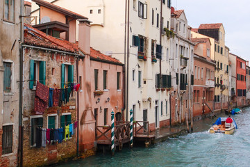 Street in Venice, Italy. Venice city famous channel lifestyle. View of usual Venice street river.