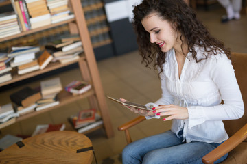 Female student studying on tablet
