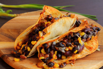 Taco with beans cheese and vegetable.