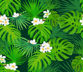 Seamless pattern with exotic tropical leaves and white flowers. Bright green leaves. Vector background.