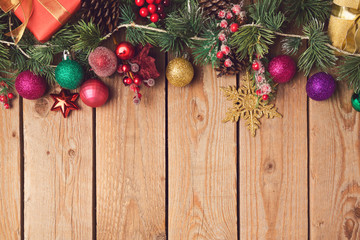 Christmas holiday wooden background with decorations and ornaments. View from above