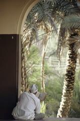 Man reading Koran in mosque