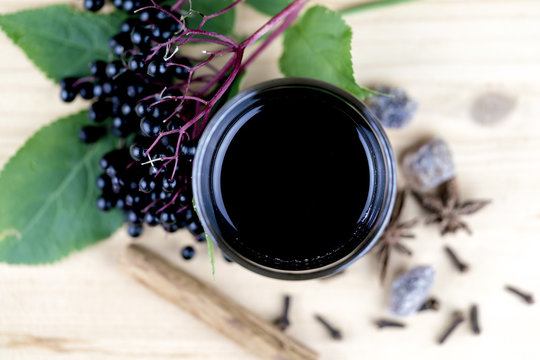 Fresh elderberry juice with berries and spices
