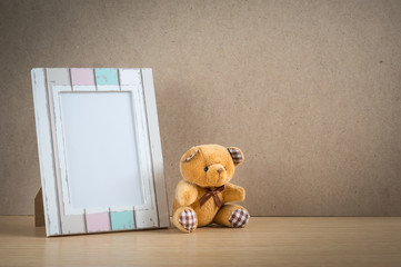 Bear doll with photo frame