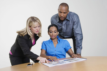 Multi ethnic office workers with manager in a meeting