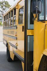Yellow school bus in parking lot