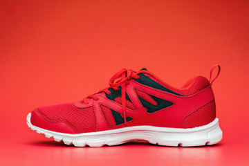 Red sport running shoes