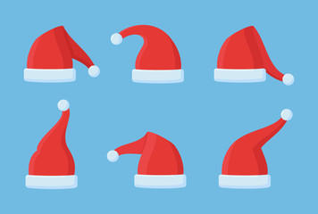 Set of Santa Claus red hats isolated on blue background. Christmas elements. Flat style vector illustration.