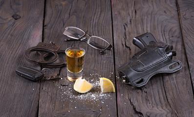 tequila, handcuffs, gun