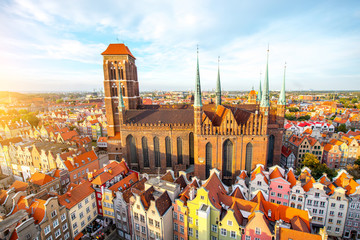 Cityscape aerial view on the old town with saint Marys church on the sunset in Gdansk, Poland Wall mural