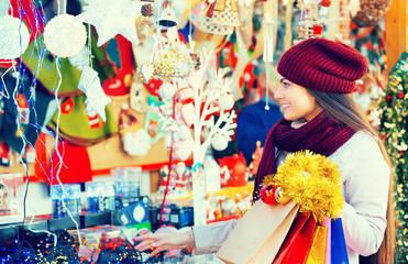 Girl choosing Christmas decoration