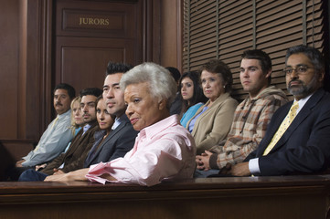 Diverse group of jurors sitting in jury box of a courtroom