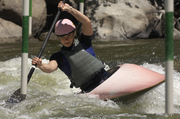 Woman struggling from a hurdle while kayaking