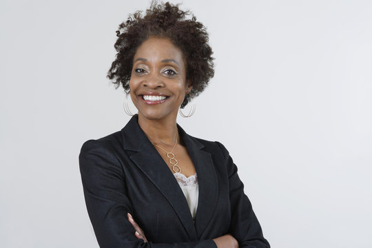 Portrait of a confident African American businesswoman with arms crossed isolated over white background