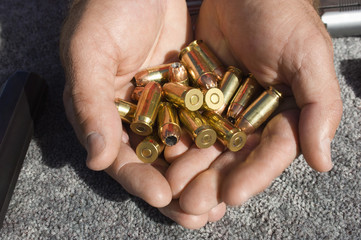 Closeup of man's cupped hands holding bullets