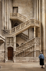Lady with walking stick looking at Booksellers' Staircase, Rouen Cathedral, Rouen, Upper Normandy, France, Europe