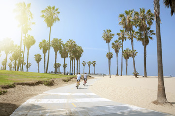 People enjoying a sunny day on the beach of Venice, California
