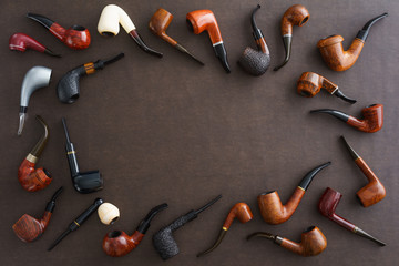 Collection of pipes with copyspace in the middle