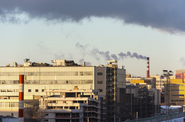 View of the working power station over a big city, industry pollution