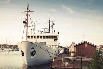 Old white ship moored in port of Kotka