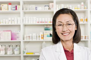 Closeup portrait of a confident smiling female pharmacist