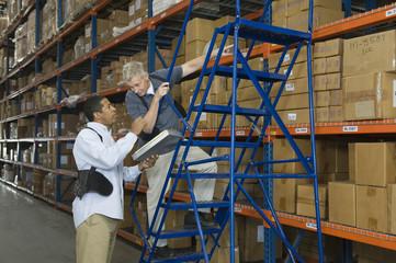 Multiethnic men working in distribution warehouse