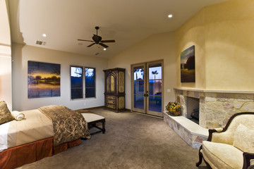 Elegant and spacious bedroom with fireplace