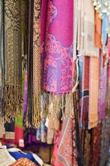Colourful pashminas and fabrics for sale at Bur Dubai souq, Dubai, UAE