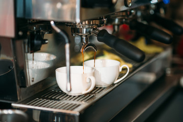 Preparation of drink in the coffee machine.