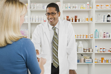Blond woman picking up prescription drugs at pharmacy