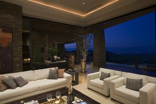 View of a luxury living room with night view through large window